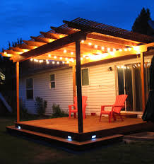 awesome pergola deck with wraparound step and strand lighting it