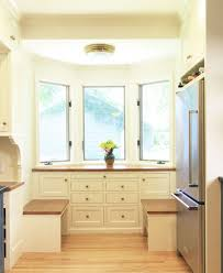 a modest kitchen remodel in minneapolis creates a mini mudroom and