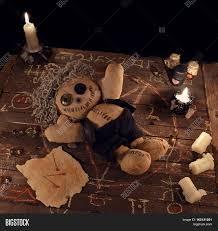 halloween background witch voodoo doll in pentagram circle on wooden planks halloween