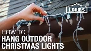 How To String Lights On Outdoor Tree Branches by How To Hang Exterior Christmas Lights Youtube