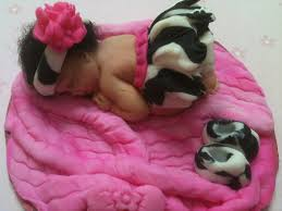 baby in a zebra print tutu baby caketopper cake