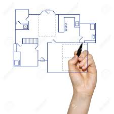 hand drafting a blueprint for a house stock photo picture and