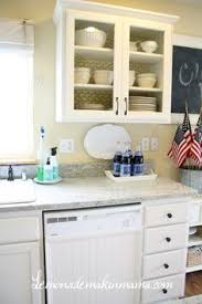 Kitchen Cabinet Upgrades by Metal Grill Inserts And White Paint Kitchen Cabinet Upgrade