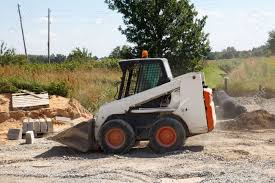 mini excavator bobcat working in construction site making new