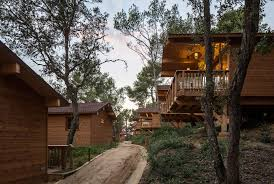 wooden houses in cadiretes forest spain dosarquitectes