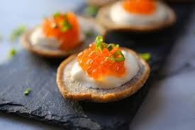 bellini canape buckwheat blinis with salmon roe and crème fraîche nerds with knives