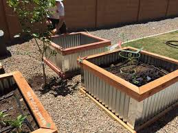 How To Make Planter Boxes by Diy Raised Garden Beds With Corrugated Metal