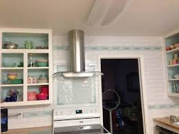 white ceramic subway tile kitchen backsplash with glass accent