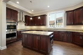 black kitchen cabinets flooring kitchen in new construction home with cherry wood cabinetry