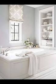 White Bathroom Shelves by Separate The Toilet From The Rest Of The Bathroom With This Pretty