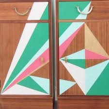 mid century geometric painted bedside cabinets by alpha fleur