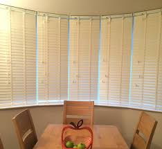 blinds for bay windows pictures business for curtains decoration white wooden blinds for emma s dining room bay window web blinds fitting blinds to a bay window may seem a daunting prospect to fit blinds to