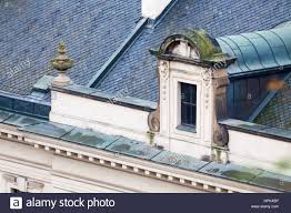 roof with vintage windows and ornamental cornice stock photo