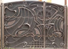 closed large metal gates with wrought iron ornaments stock photo