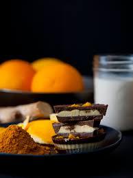 ginger turmeric dark chocolate cups with maple orange cashew cream