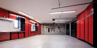 gray epoxy floor large home garage design with red and black