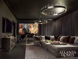 Circa Lighting Chandeliers This Media Room Evokes Masculinity With The Industrial Chandeliers