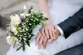 wedding flowers groom and groom s with wedding rings and bouquet of flowers