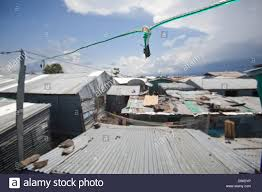 basic electric wiring linking homes in a slum with a diesel
