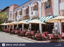 Customers Dining At Outdoor Tables Italian Restaurant On