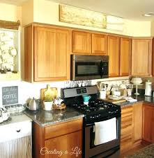 ideas for decorating above kitchen cabinets ideas for top of kitchen cabinets creative ideas for decorating