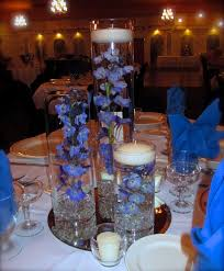 Simple Elegant Centerpieces Wedding by Trio Vase With Blue Delphinium With Our Floating Candles Simple