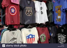 t shirts for sale on a market stall in thailand stock photo