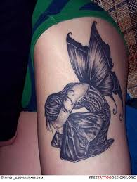 sad and wing on leg tattoomagz
