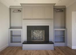 black built ins fireplace with gray built ins transitional living room