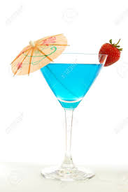 martini strawberry blue martini cocktail with strawberry and umbrella stock photo