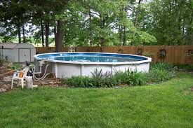 outdoor landscaping around above ground pool deck above ground