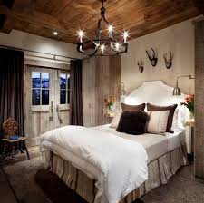 white wall paint and double bed plus canopy in country bedroom