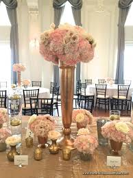 tall and low pink and white centerpieces of hydrangea and roses in