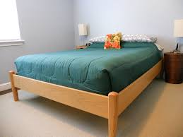 simple maple wood frame bed frame using green bedding set combined white
