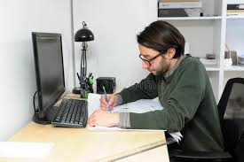 desk types young architect male in casual wear working in office on desk types