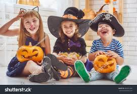 halloween background with silhouettes of children trick or treating in halloween costume happy brother two sisters on halloween stock photo 482851483