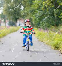 raincoat for bike riders happy funny kid boy 4 years stock photo 344976008 shutterstock