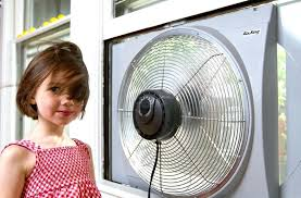 electrically reversible twin window fan reversible window fan the authors daughter feels the breeze from air