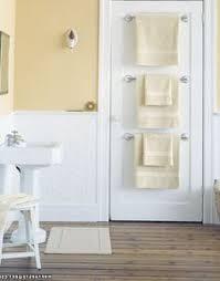 small bathroom towel rack ideas 8 ways to a small bathroom look big towel rod towels and doors