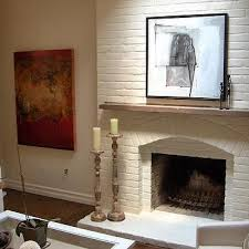 red brick fireplace with white mantle design ideas