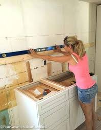 putting up kitchen cabinets putting up kitchen cabinets frequent flyer miles