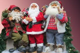using santa claus figures to decorate with