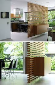 best 25 room dividers ideas on pinterest tree branches 15 creative ideas for room dividers this slatted wooden room divider has a built in cabinet