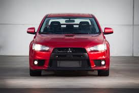 the mitsubishi e evolution wants mitsubishi delays new evo to focus on mainstream models and evs