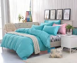 white wooden classic bed white striped zebra bedding grey carpet