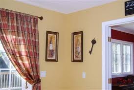eddie bauer bungalow gold paint wall color with red curtains 31252