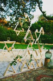 wedding backdrop greenery picture of triangle installation with greenery and some blooms