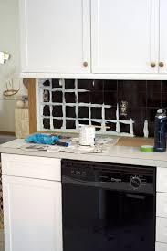 painting kitchen tile backsplash how to paint your tile backsplash brepurposed