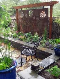 Outdoor Patio Partitions A Beautiful Custom Metal Art Plate Is Used As A Focal Point For