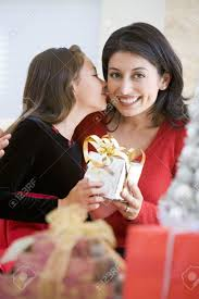 surprising her mother with christmas gift stock photo